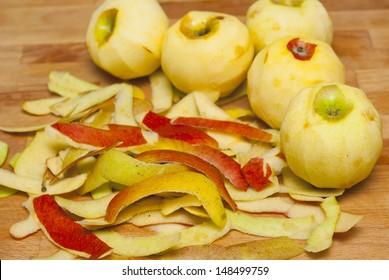 peeled apples on cutting board