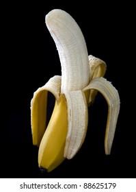 Peeled banana on a dark background