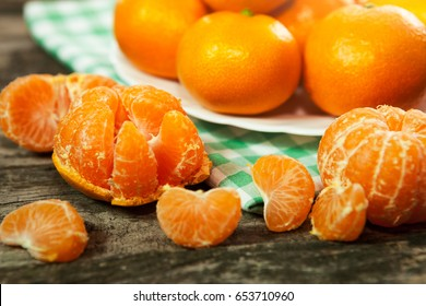 Peeled fresh clementines with kitchen cloth on the table