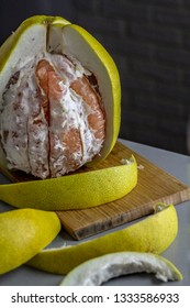 Peeled fresh red pomelo on the table