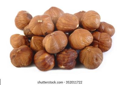 peeled hazelnuts isolated on white background