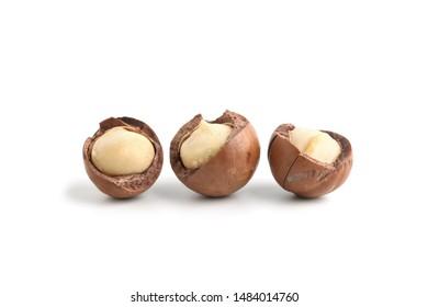 Peeled macadamia nuts isolated on white background.