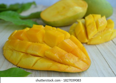 Peeled Manalagi Mangoes on wooden table. Selective focus
