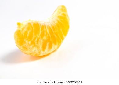 Peeled orange mandarin or tangerine fruit isolated on white background