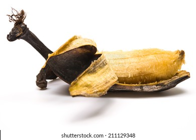 peeled overripe banana on a white background