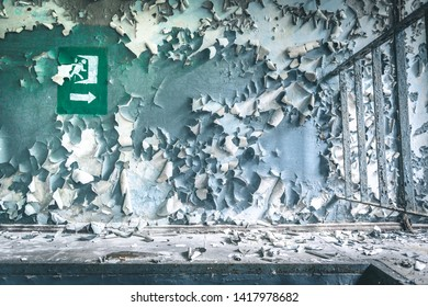 peeled paint on the wall of a desolate building in Pripyat