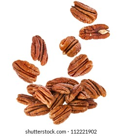 Peeled pecan nuts close up, isolated on white background