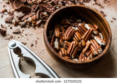 Peeled Pecan Nuts in Wooden Bowl without Shell / Walnuts.