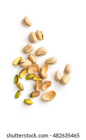 Peeled pistachio nuts isolated on white background. Top view.