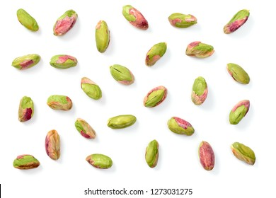 peeled pistachios isolated on the white background, top view
