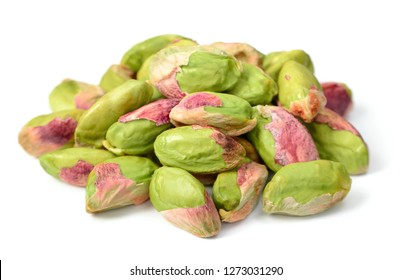 peeled pistachios isolated on the white background