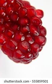 peeled pomegranate fruit closeup on white background