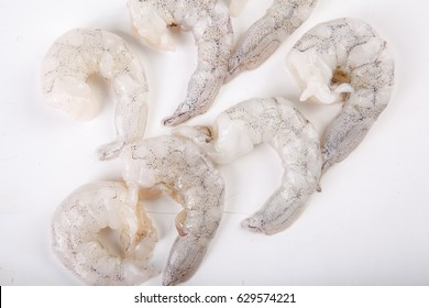 Peeled Raw food shrimps with white background
