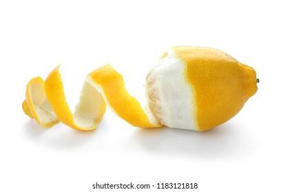Peeled ripe lemon on white background