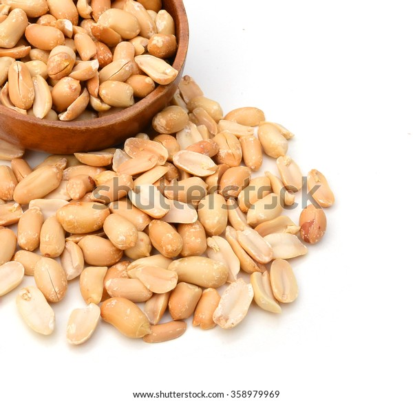 Peeled salted peanuts isolated on white background