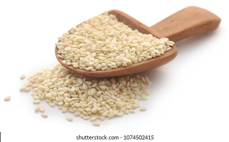 Peeled sesame seeds over white background