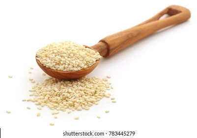 Peeled sesame seeds over white background