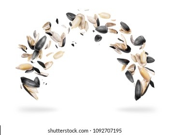 Peeled sunflower seeds are frozen in the air, isolated on white background