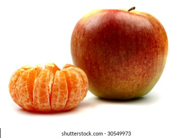 peeled tangerine with red apple
