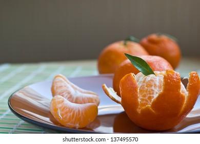Peeled tangerine with segments