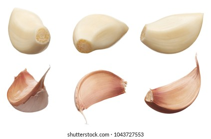 Peeled and unpeeled cloves of garlic in different angles isolated on white background