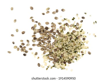 Peeled and unpeeled hemp seeds pile isolated on white background, top view