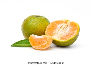 Peeled and unpeeled of juicy Orange Tangerine fruit with green leaf isolated on white background.