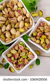 Peeled and unpeeled pistachios with green napkin