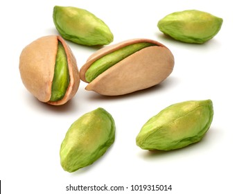 Peeled and unpeeled pistachios isolated on white background