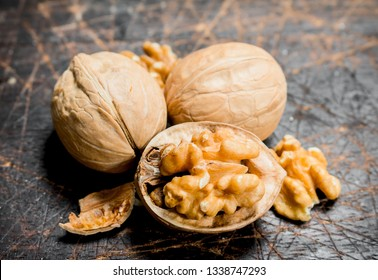 Peeled walnut . On a wooden background