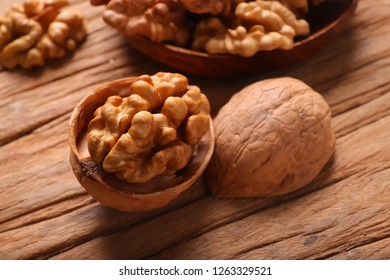 Peeled walnuts on a wooden board