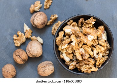 peeled and whole walnuts table top view