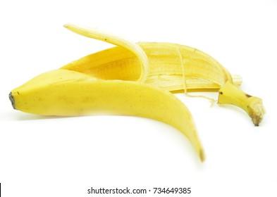 Peeled yellow banana skin on white background, Selective focus