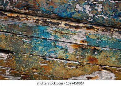 Peeling blue paint background wood texture with harsh shaddows