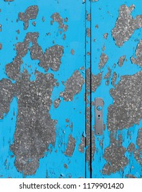 Peeling blue paint on metal door on West Street in St. Anthony, Newfoundland and Labrador
