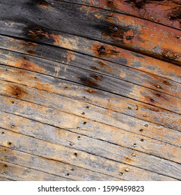 Peeling brown paint background texture with harsh shaddows