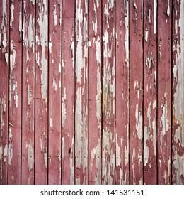 Peeling brown paint on weathered wood texture