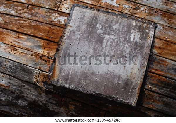 Peeling brown plank background texture with copy space for text