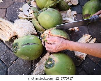 Peeling coconut shell off