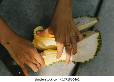 Peeling durian by bare hand
