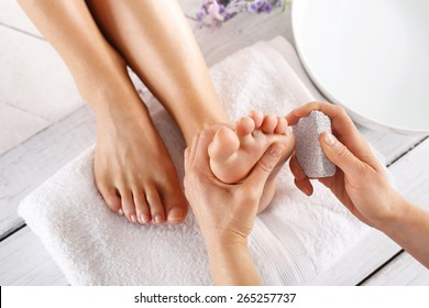 Peeling feet pedicure treatment.Foot care treatment and nail, the woman at the beautician for pedicure.