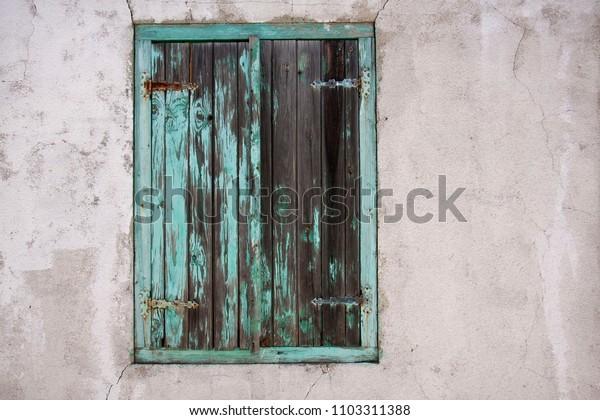 peeling green shutters