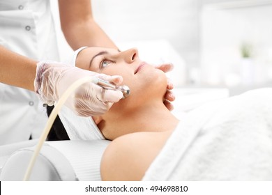 Peeling machine. Diamond microdermabrasion. woman during a microdermabrasion treatment in beauty salon