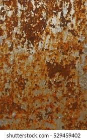 peeling old oil paint on rusty metal. Textured surface