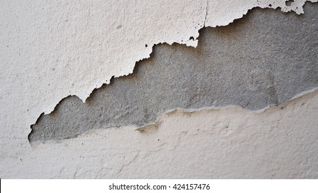 Peeling paint on a concrete wall