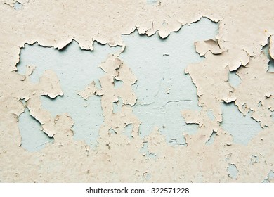 Peeling paint on a metal surface