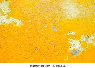 Peeling paint on wall texture. yellow background
