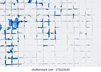 Peeling paint on a wall of tiles as a background image