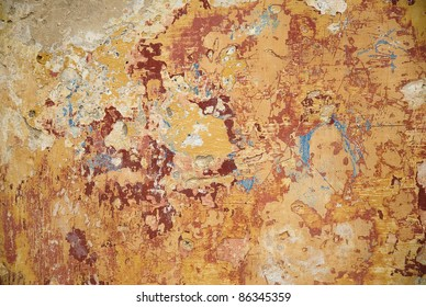 peeling paint texture with several warm colors