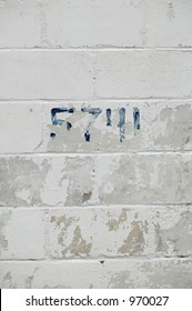 Peeling painted brick wall with numbers - vertical